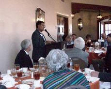 """Rep. Roger Madalena speaks at the luncheon after being named """"Legislator of the Year."""""""